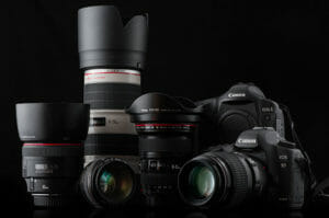 Canon camera and lenses on black background