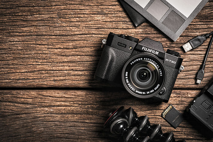 Fuji mirrorless camera on a wooden table looking down on to camera