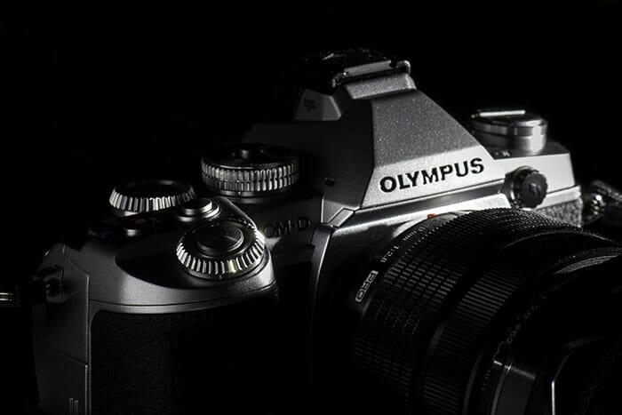 Olympus camera on black background