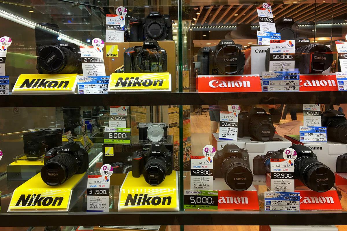 Canon and Nikon cameras in a shop window
