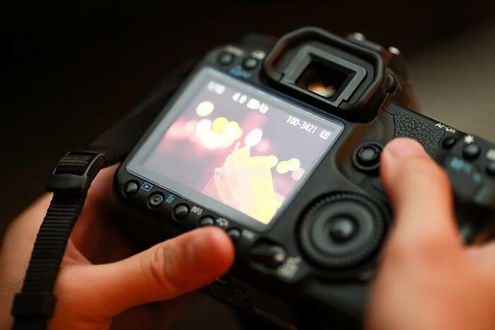 Canon camera screen held in hand