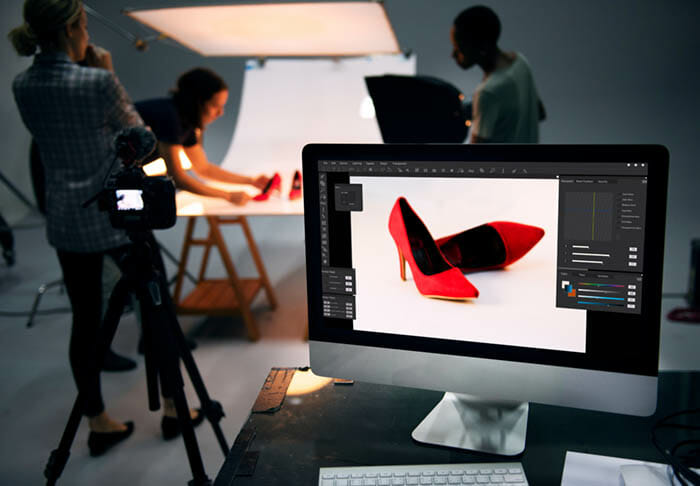 red shoes on a computer screen in a photography studio
