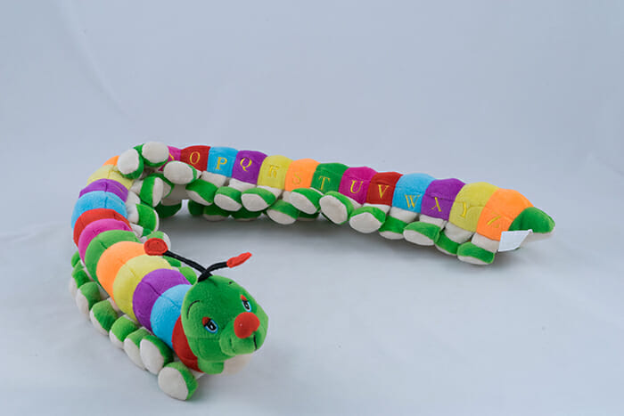 Colourful Children's Toy Caterpillar on a grey background