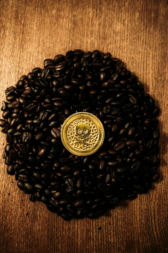 How to do product photography flat lay coffee beans with a skull coin in the middle