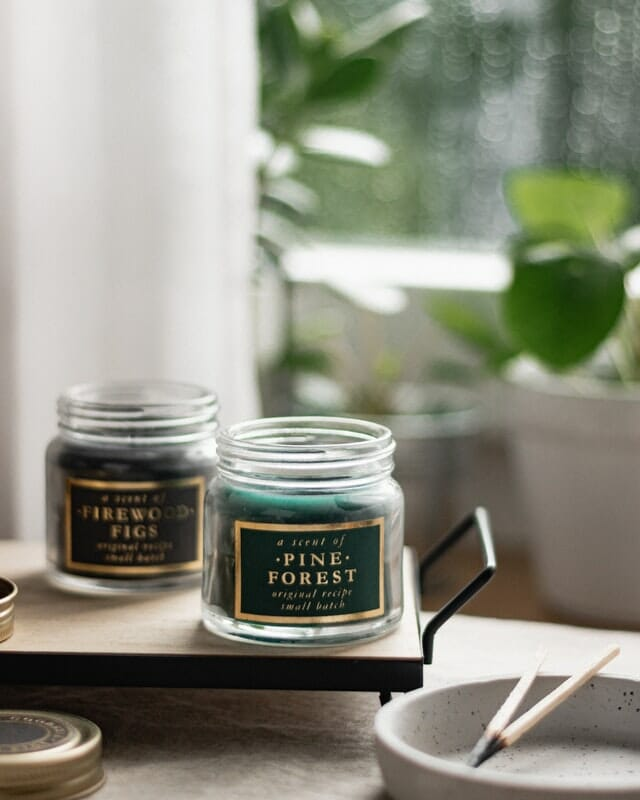 how to do product photography two green candles sat by a window