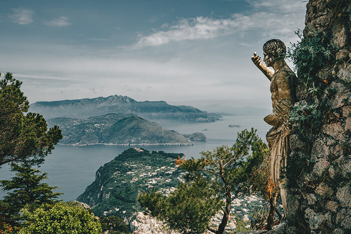 holiday photography statue overlooking town